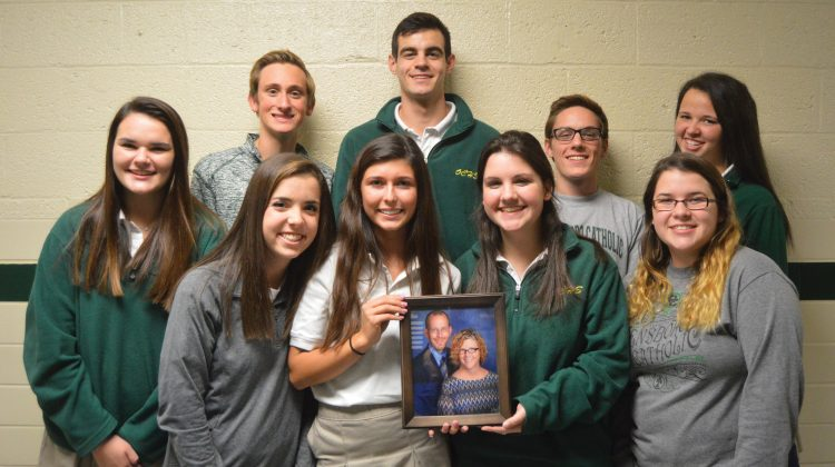 Group Photo of Students Holding Picture of their Teacher