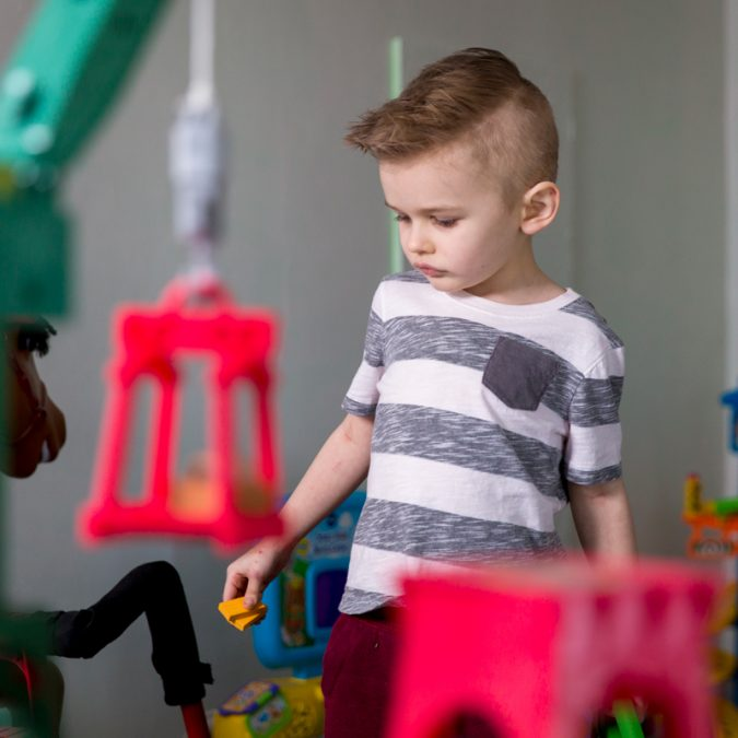 Young Boy Playing in Toy Room