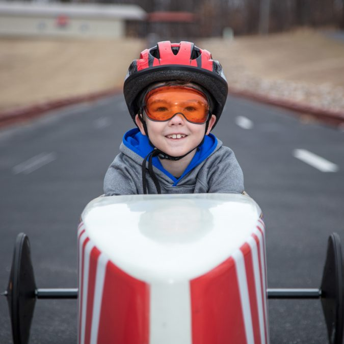 Young Boy in Soap Box Derby Car