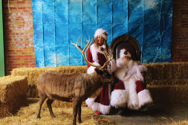 Santa and Mrs. Claus with reindeer