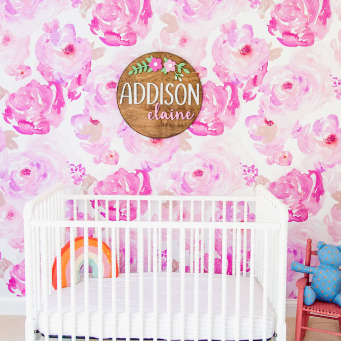 Daughter Addison's bedroom with bright pink, floral wallpaper and wooden sign that says her name