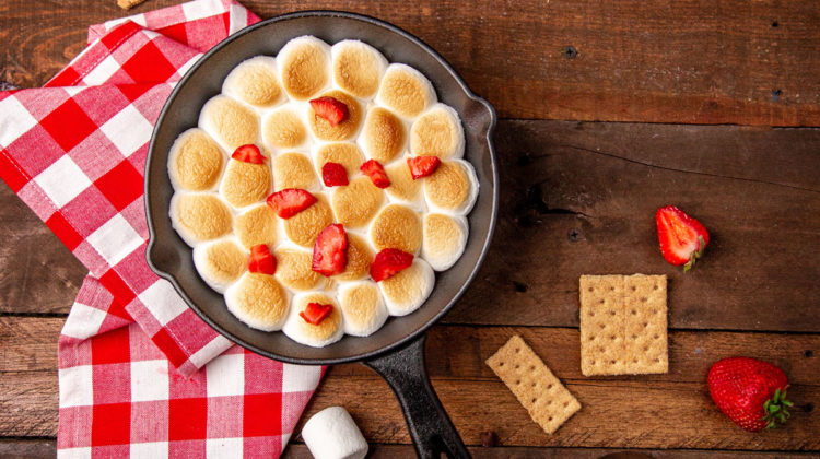 Indoor s'mores dip with strawberries on top