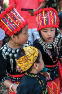 Children wear ceremonial costumes from various cultures