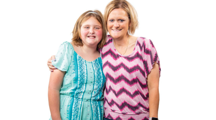 Portrait on white background of Jennifer Hulsey and her granddaughter
