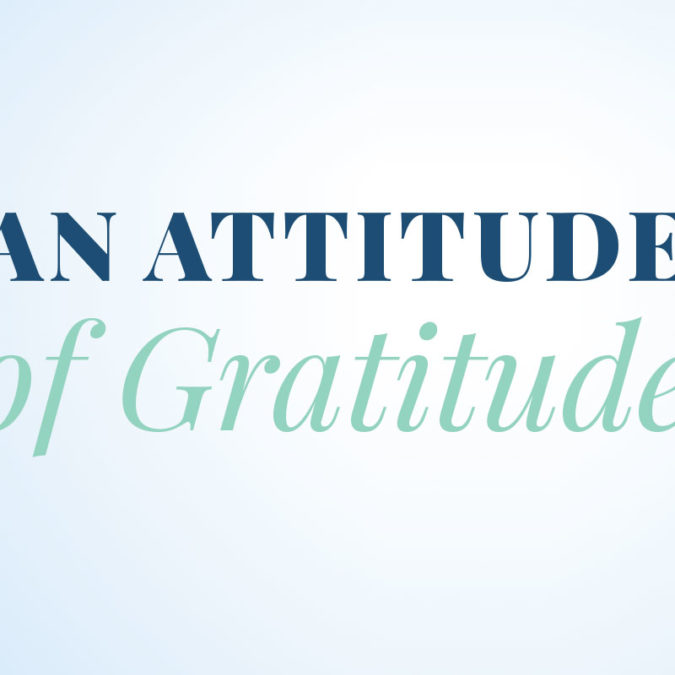 """""""An Attitude of Gratitude"""" writted on light blue background"""
