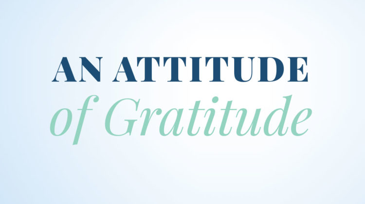 """An Attitude of Gratitude"" writted on light blue background"