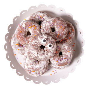 donuts that look like little monsters with googly eyes