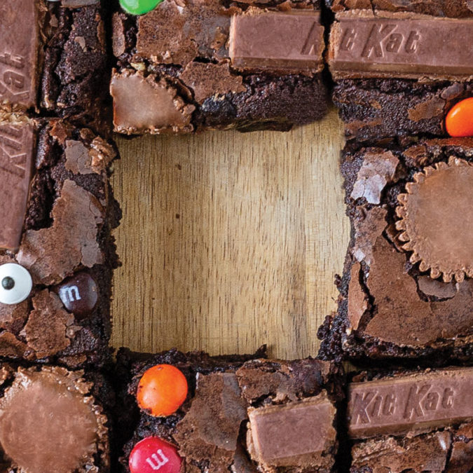 Overhead photo of brownies with leftover Halloween candy in them