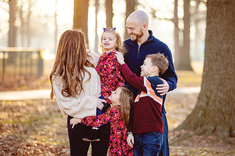 The Hayden family smiling and laughing during a group photo