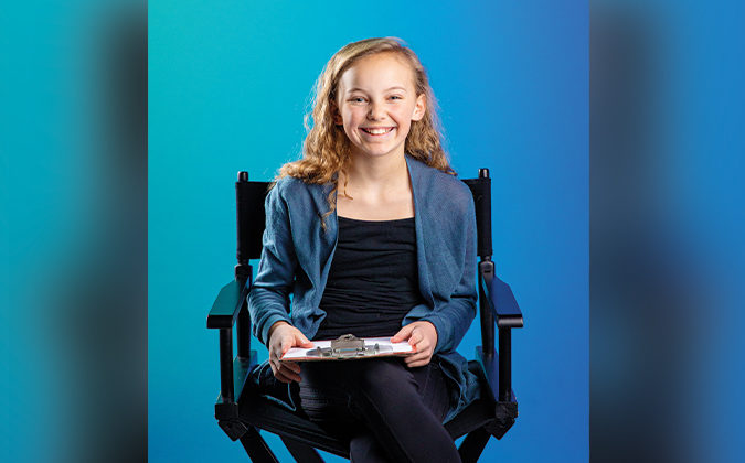 Addie Mae Lanham sitting in a directors chair