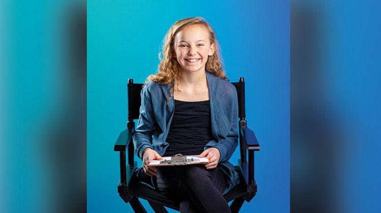 Addie Mae Lanham sitting in a directors chair
