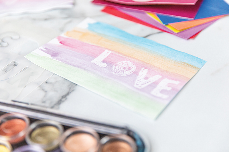 """""""Love"""" written with watercolors"""